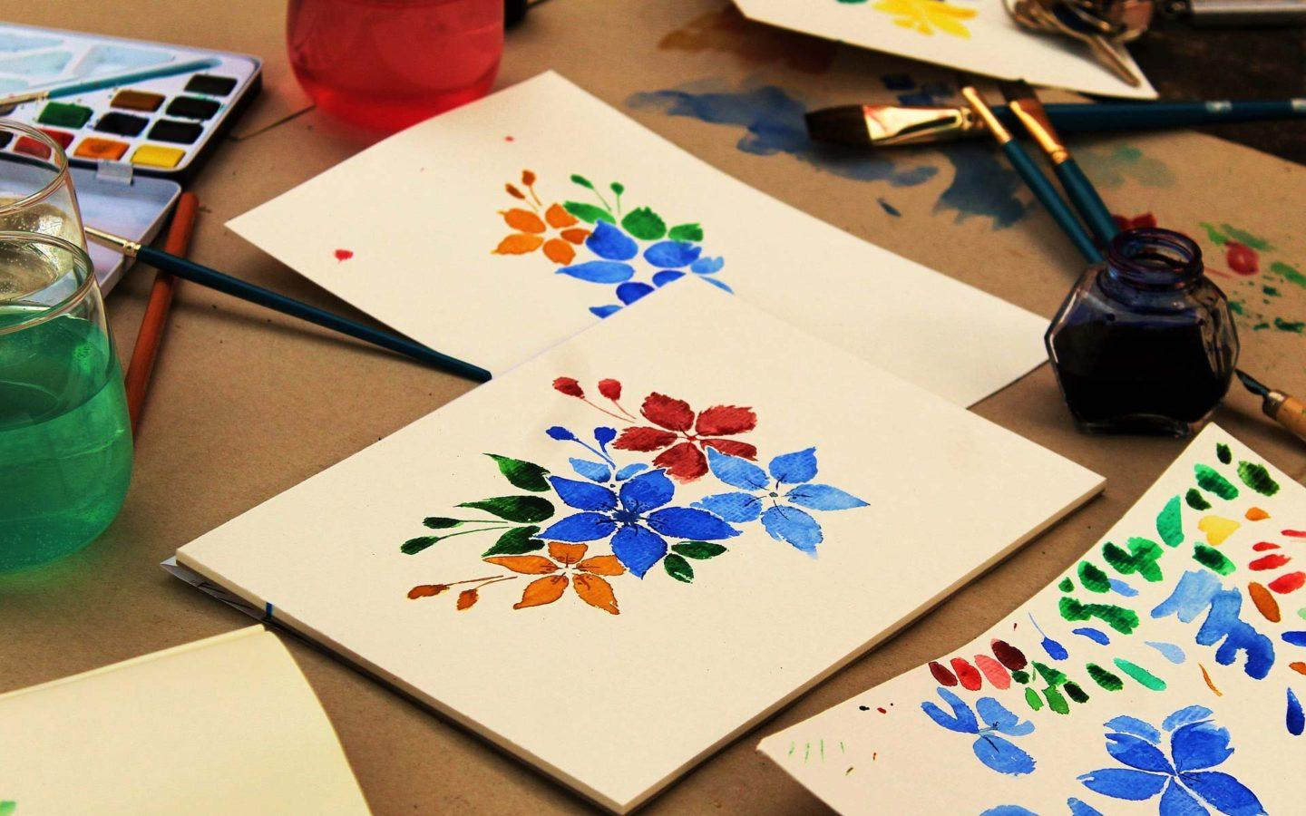 a watercolour painting of flowers on a white canvas